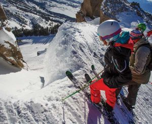 Skiers look into the entrance of Corbet's Couloir.